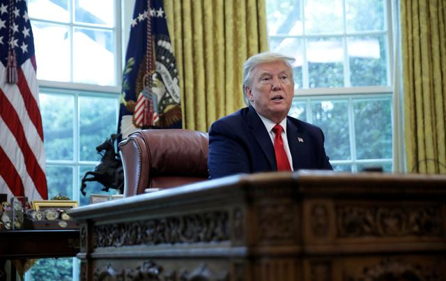 FILE PHOTO: U.S. President Donald Trump answers questions during an interview with Reuters about China, the novel coronavirus (COVID-19) pandemic and other subjects in the Oval Office of the White House in Washington, U.S., April 29, 2020. REUTERS/Carlos Barria