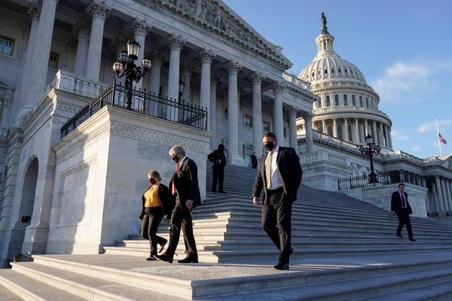 Members of the U.S. Congress depart after voting on impeachment against U.S. President Donald Trump at the U.S. Capitol, in Washington, U.S. January 13, 2021. REUTERS/Joshua Roberts
