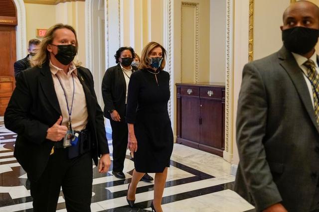 U.S. House Speaker Nancy Pelosi (D-CA) walks through the U.S. Capitol, as Democrats debate one article of impeachment against U.S. President Donald Trump, in Washington, U.S. January 13, 2021. REUTERS/Joshua Roberts
