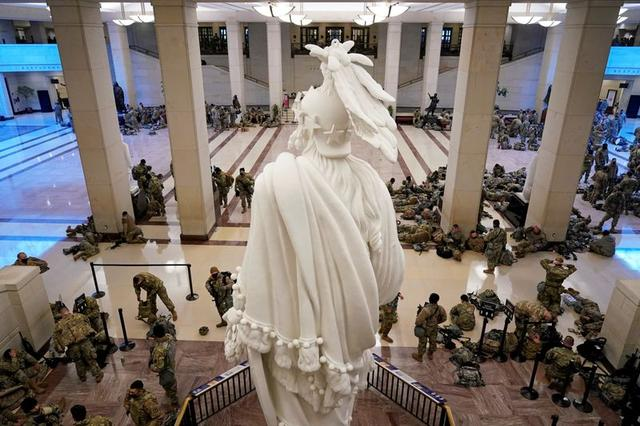 National Guard members assemble in the Capitol Visitor's Center on Capitol Hill before Democrats begin debating one article of impeachment against U.S. President Donald Trump at the U.S. Capitol, in Washington, U.S., January 13, 2021. REUTERS/Joshua Roberts