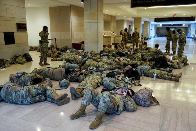 National Guard members sleep in the Capitol Vistor's Center on Capitol Hill before Democrats begin debating one article of impeachment against U.S. President Donald Trump at the U.S. Capitol, January 13, 2021. REUTERS/Joshua Roberts