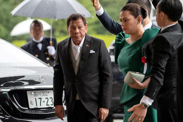 FILE PHOTO: Philippines President Rodrigo Duterte arrives with daughter and first lady Sara Duterte-Carpio to attend the enthronement ceremony of Japan's Emperor Naruhito in Tokyo, Japan October 22, 2019.  Carl Court/Pool via REUTERS