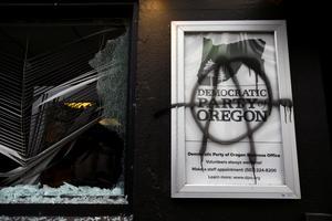 Anti-fascist protesters vandalize buildings in Portland