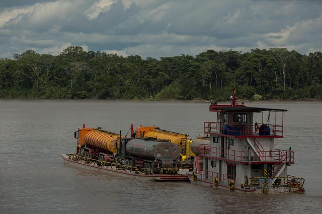 Tanker trucks are being transported on the river Napo, Ecuador May 11, 2020. Ivan Castaneira/Amazon Watch/Handout via REUTERS