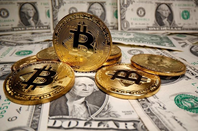 Image result for Dollar slumps as U.S. Treasury yields soften, but bitcoin eyes $50,000