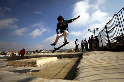 High above Jerusalem's crowds, skating the Old City rooftops