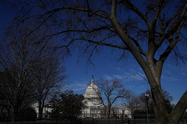 FILE PHOTO: Barbed wire and security fencing surrounds the U.S. Capitol in Washington, U.S., February 5, 2021. REUTERS/Sarah Silbiger