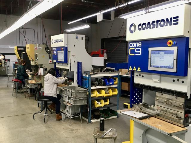 Operators use servo brake presses to form laser-cut steel blanks at Scandic Springs' factory in San Leandro, California, U.S. February 17, 2021. Scandic Springs Inc/Handout via REUTERS.