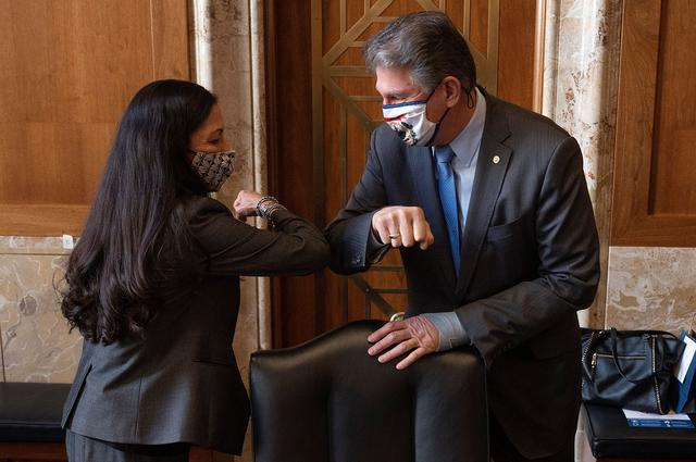 Chairman Joe Manchin, D-WV, greets Congresswoman Deb Haaland, D-NM, during the Senate Committee on Energy and Natural Resources hearing on her nomination to be Interior Secretary on Capitol Hill in Washington, DC, U.S. February 23, 2021.    Jim Watson/Pool via REUTERS