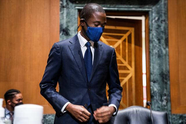 Economist Adewale ''Wally'' Adeyemo prepares to testify before the Senate Finance Committee during his confirmation hearing to be Deputy Secretary of the Treasury in the Dirksen Senate Office Building, in Washington, D.C., U.S., February 23, 2021. Jim Lo Scalzo/Pool via REUTERS
