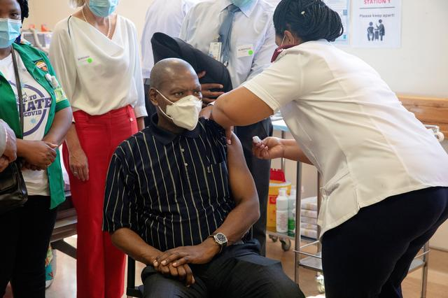FILE PHOTO: South African Health Minister Zweli Mkhize receives the Johnson and Johnson coronavirus disease (COVID-19) vaccination at the Khayelitsha Hospital near Cape Town, South Africa, February 17, 2021. Gianluigi Guercia/Pool via REUTERS
