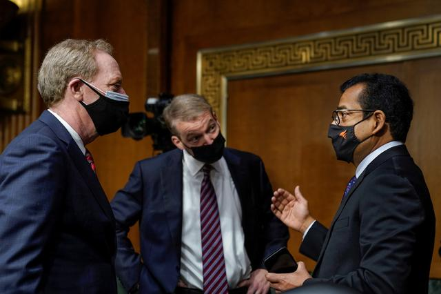 FireEye CEO Kevin Mandia, SolarWinds CEO Sudhakar Ramakrishna and Microsoft President Brad Smith speak with each other before the start of a Senate Intelligence Committee hearing on Capitol Hill, in Washington, D.C., U.S., February 23, 2021. Drew Angerer/Pool via REUTERS