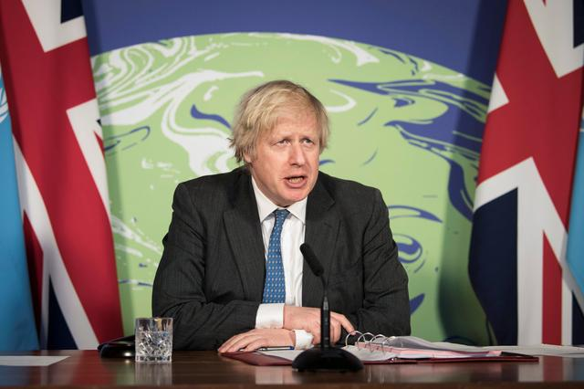 Prime Minister Boris Johnson chairs a session of the UN Security Council on climate and security at the Foreign, Commonwealth and Development Office in London, Britain February 23, 2021. Stefan Rousseau/Pool via REUTERS
