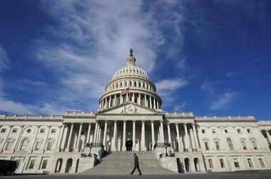 FILE PHOTO: A man walks past the U.S. Capitol in Washington