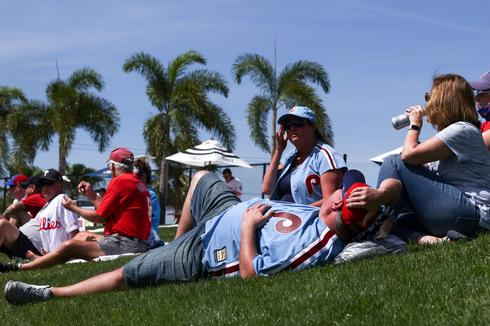 From Florida to San Francisco, Americans flock to movies, bars and ballparks