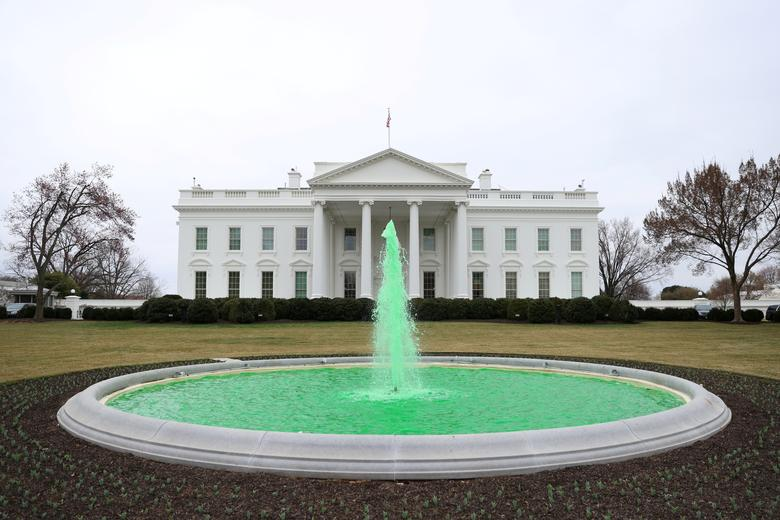 The North Lawn fountain is dyed green for St. Patrick's day at the White House in Washington. REUTERS/Tom Brenner