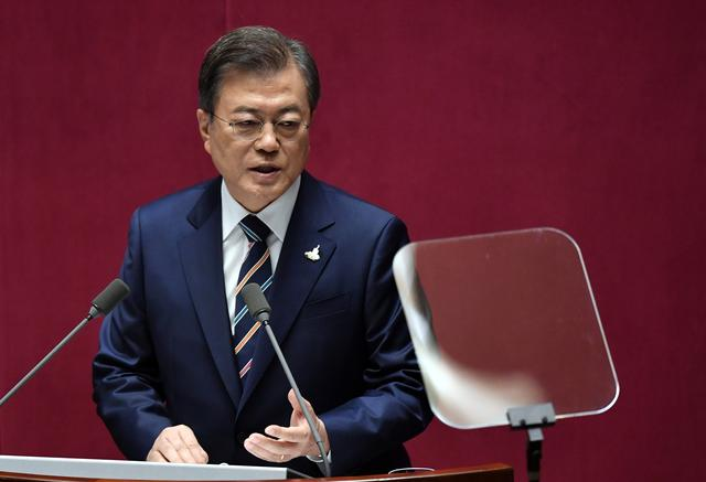 FILE PHOTO: South Korea's President Moon Jae-in delivers a speech during the opening ceremony of the 21st National Assembly, in Seoul, South Korea July 16, 2020. Jung Yeon-je/Pool via REUTERS