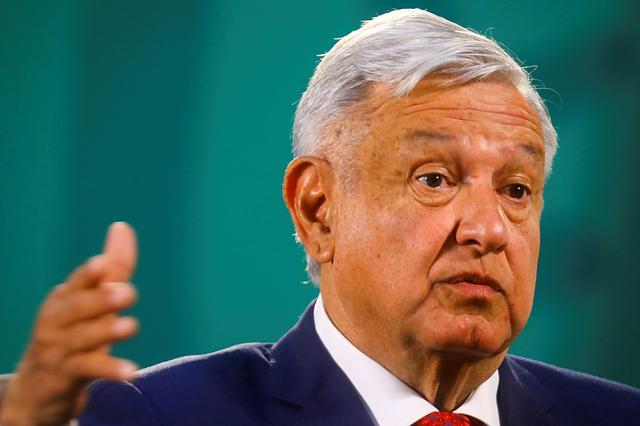 FILE PHOTO: Mexico's President Andres Manuel Lopez Obrador gestures as he speaks during a news conference at the National Palace, in Mexico City, Mexico, March 24, 2021. REUTERS/Edgard Garrido/File Photo