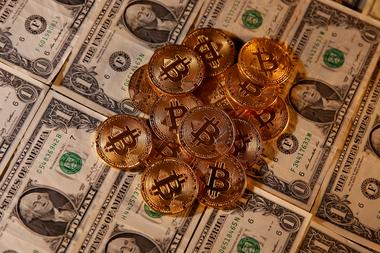 FILE PHOTO: Representations of virtual currency Bitcoin and U.S. dollar...