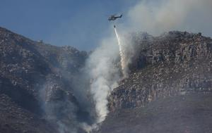 Firefighters battle mountain fire outside Cape Town
