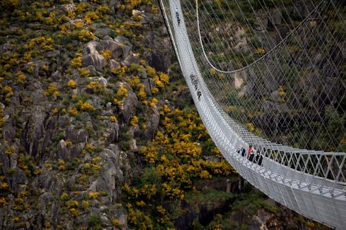 High anxiety: World's longest pedestrian suspension bridge opens
