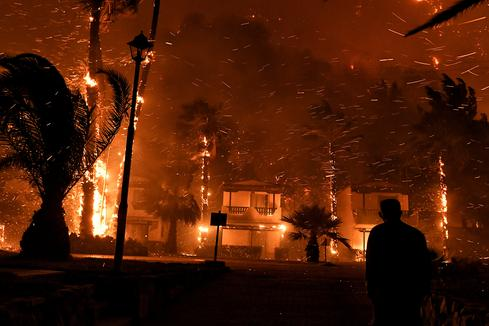 Greece evacuates residents as forest fire spreads