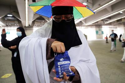 Immunized pilgrims gather for haj as COVID restrictions limit numbers