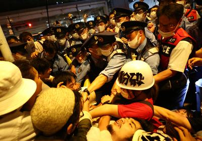 Protesters scuffle with police outside Tokyo opening ceremony stadium