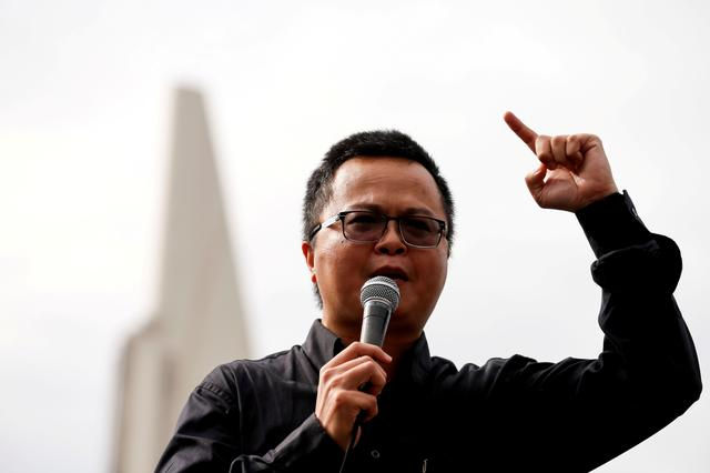 FILE PHOTO: Human rights lawyer Arnon Nampa speaks during a Thai anti-government mass protest, on the 47th anniversary of the 1973 student uprising, in front of the Democracy monument, in Bangkok, Thailand October 14, 2020. REUTERS/Soe Zeya Tun/File Photo