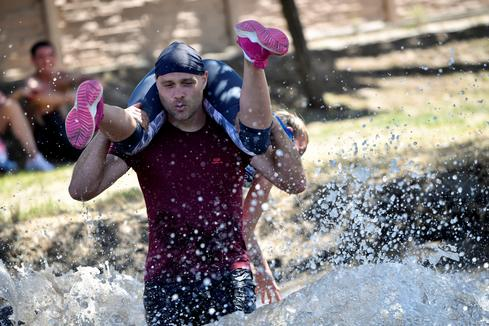 Hungarians grab their partners in wife-carrying contest