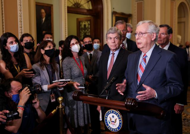 U.S. Senate Republican Leader Mitch McConnell (R-KY) speaks to reporters as Senators' Roy Blunt (R-MO), John Thune (R-SD) and John Barrasso (R-WY) stand by following the weekly Senate Republican policy lunch at the U.S. Capitol in Washington, U.S., September 14, 2021. REUTERS/Evelyn Hockstein