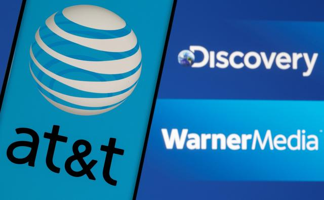 FILE PHOTO: AT&T logo is seen on a smartphone in front of displayed Discovery and Warner Media logos in this illustration taken May 17, 2021. REUTERS/Dado Ruvic