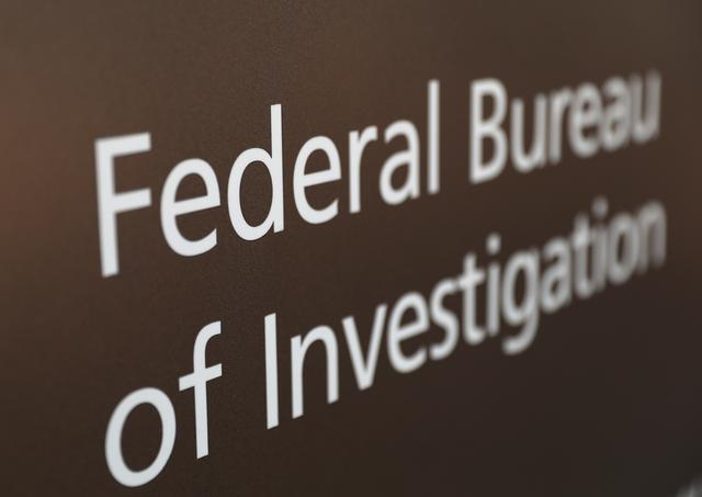 A sign of the Federal Bureau of Investigation is seen outside of the J. Edgar Hoover FBI Building in Washington, March 12, 2019. REUTERS/Leah Millis