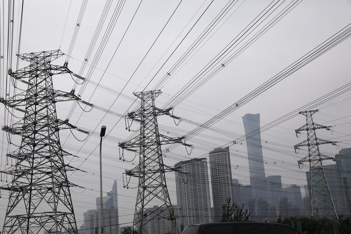 Electricity transmission towers near Beijing's Central Business District...
