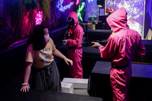 Customers play Squid Game at Jakarta cafe